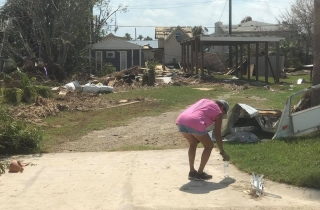This is the way most everything looked. This woman seemed to be in shock – she walked past the piles of debris to pick up a single bottle of trash.