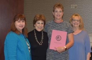 Janie DeJesus, Director of Awards, Mary Garrison, President, Karen Barret, President Elect pictured with Melinda Cordova, Secretary and her new pink binder.
